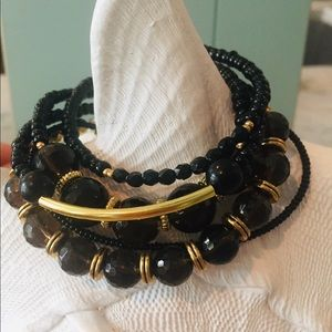 5 Strand Black Beads With Gold Spacers &Clasp